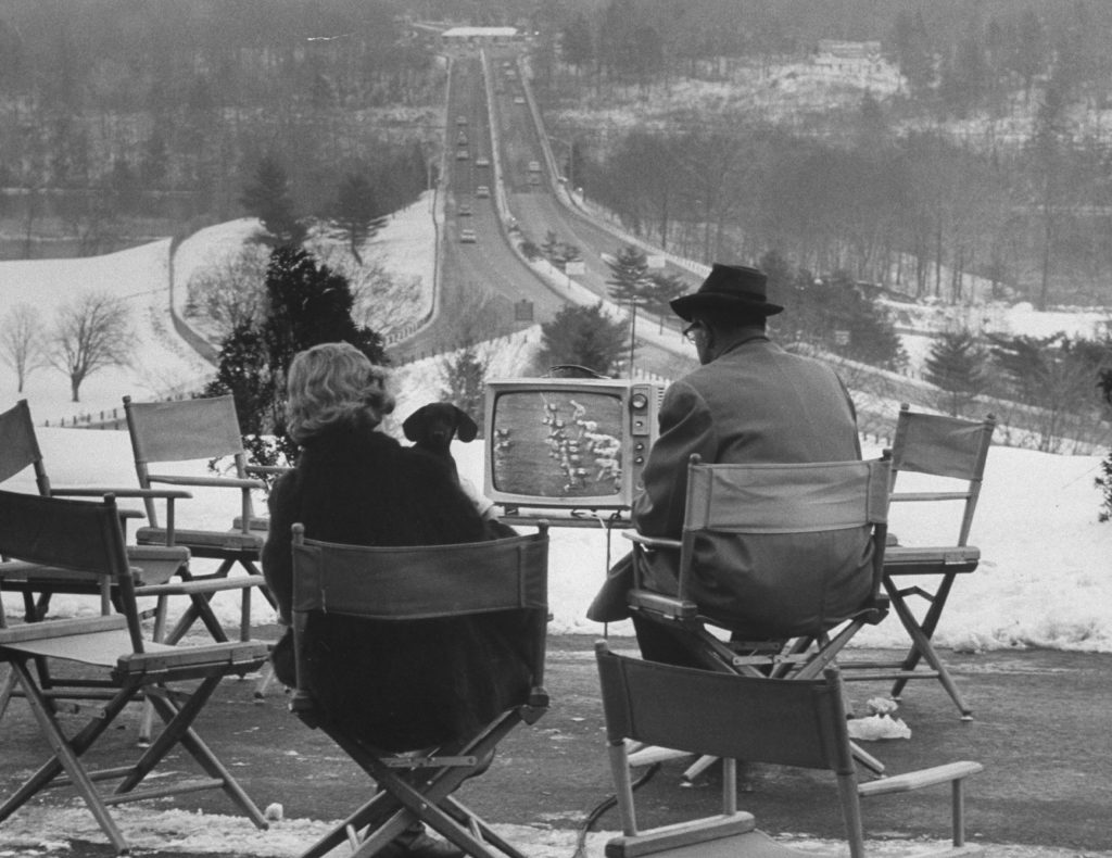 Die-hard New York Giants fans watch the 1962 NFL championship game against the Packers outside a Connecticut motel, beyond the range of the NYC-area TV blackout, December 1962. Green Bay won, 16-7.