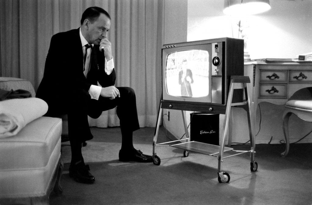 Frank Sinatra watches his son, Frank Jr., 21, emcee a TV show, 1964.