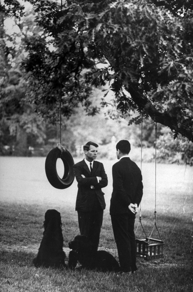 Under a tree hung with swings at Hickory Hill, Bob and Ted have a last talk about Bob's possible plans for entering the New York Senate race.
