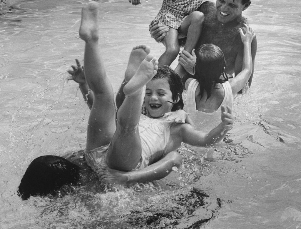 Caroline Kennedy, legs tangled in a cousin's, tumbles off a submerged Pierre Salinger. They lost a watery jousting match with Bob and two of his daughters.