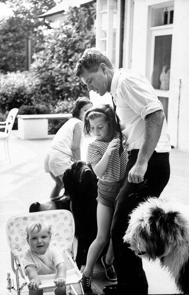 Robert Kennedy with his niece, Caroline; his son, Christopher (in pram); and his daughter, Courtney, 1964.