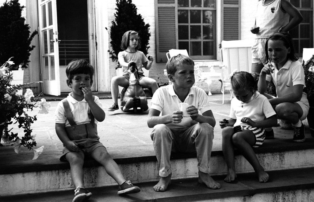 John Kennedy Jr. (left) and his sister Caroline and their cousins David, Kerry and Courtney Kennedy, 1964.
