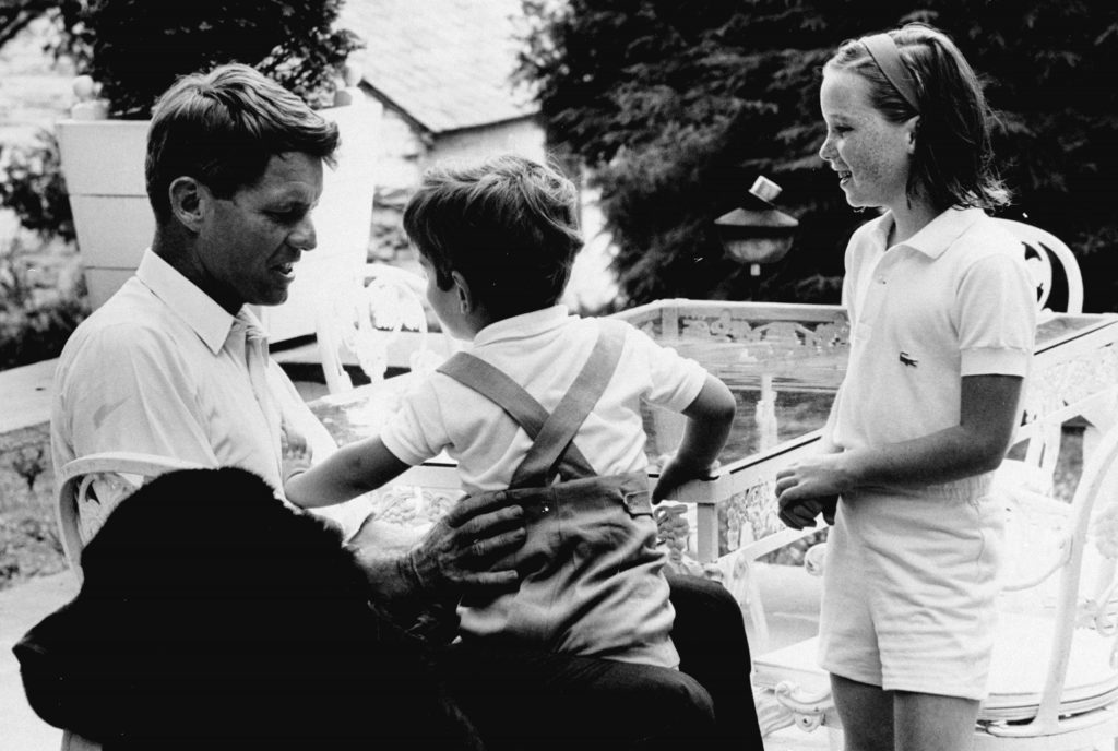 Robert Kennedy with John Kennedy Jr. and his daughter Courtney, 1964.