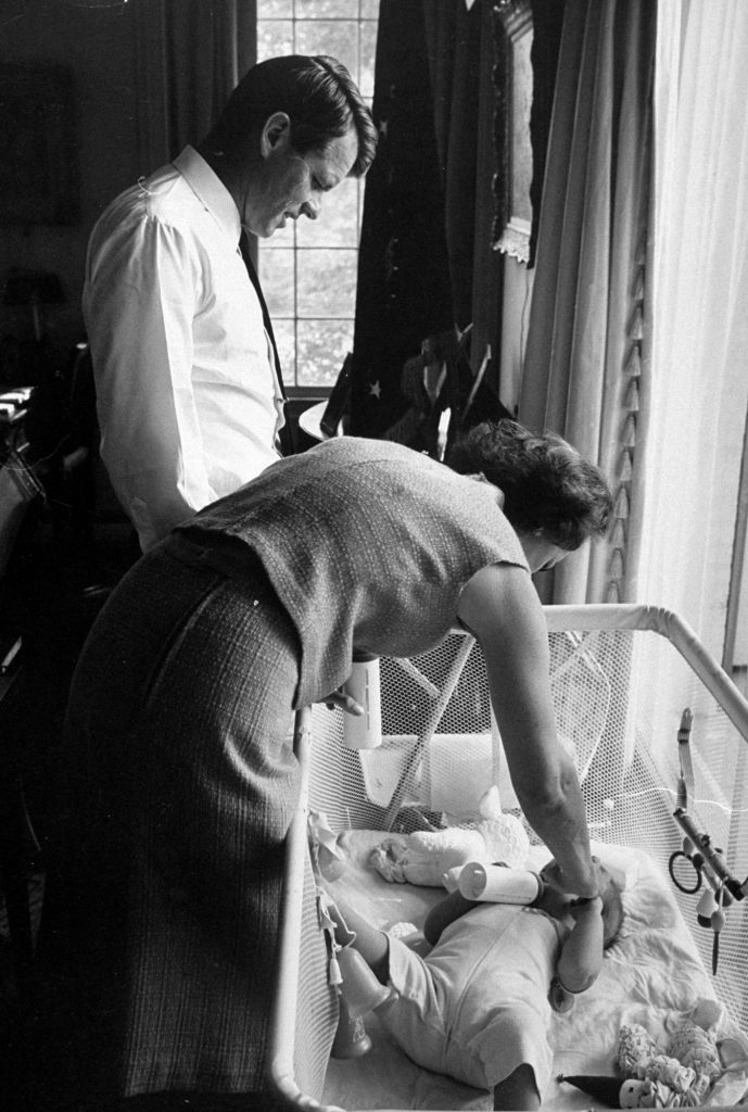 Robert F. Kennedy and his wife Ethel putting their one-year-old son, Christopher, down for a nap, 1964.