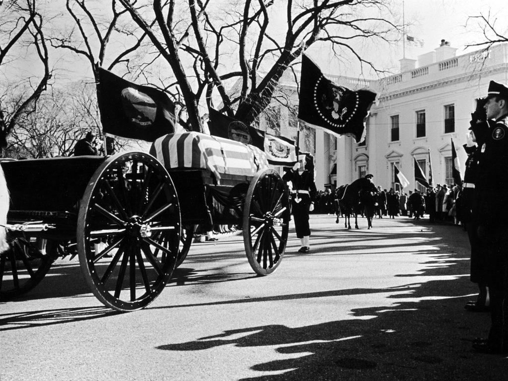 John F. Kennedy's cortege leaves the White House, November 1963.