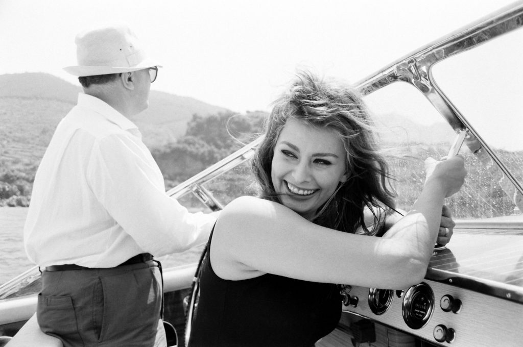 Sophia Loren with her husband Carlo Ponti on a boating trip off of Naples, 1961.