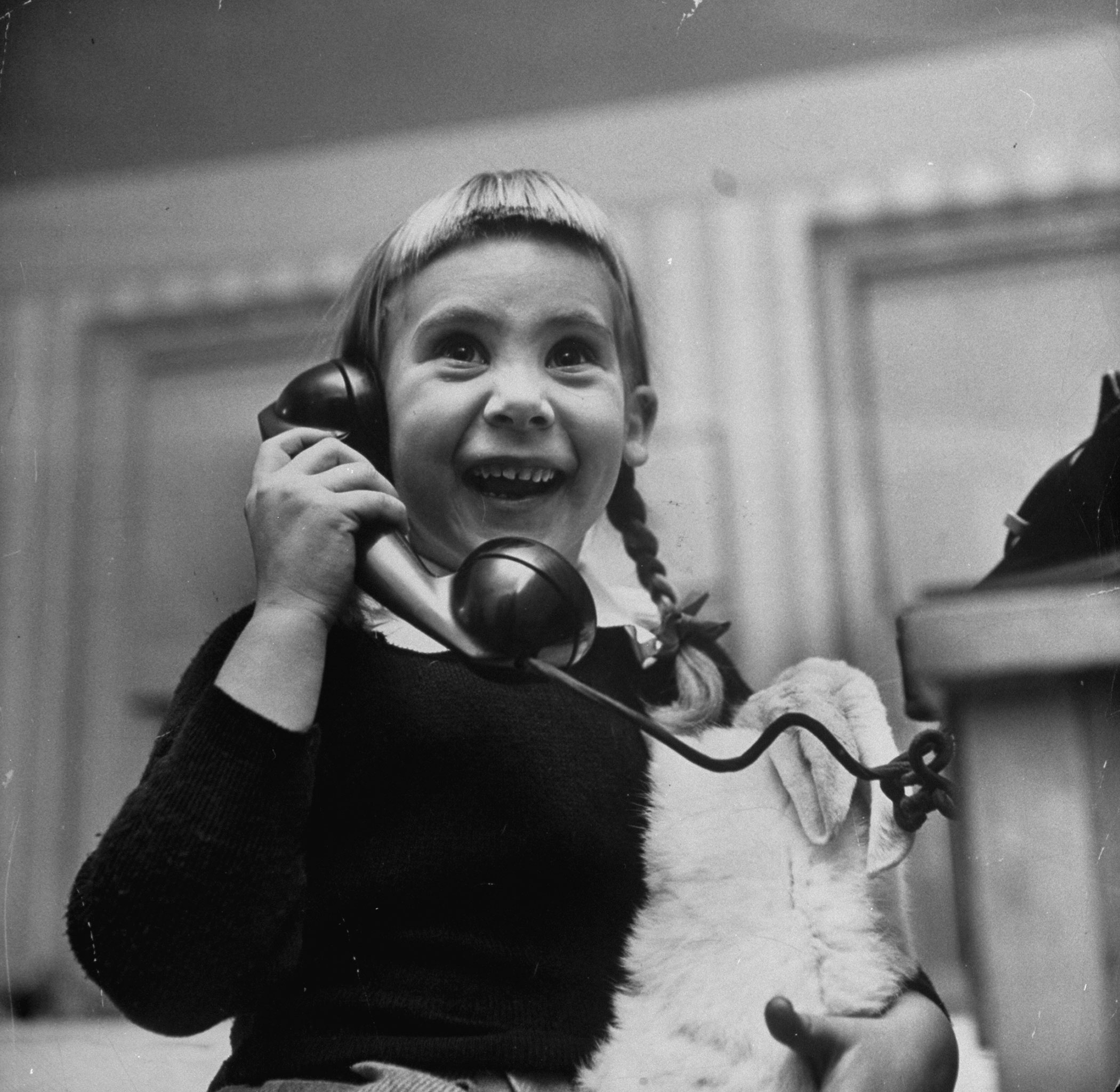 Patricia Guinan promises to leave out milk and crackers for Santa Claus on Christmas Eve, 1947.