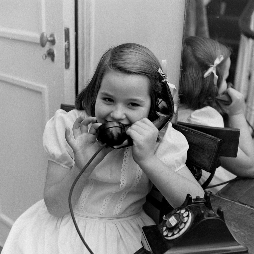 Bann Kernan, 7, calls Santa, 1947.