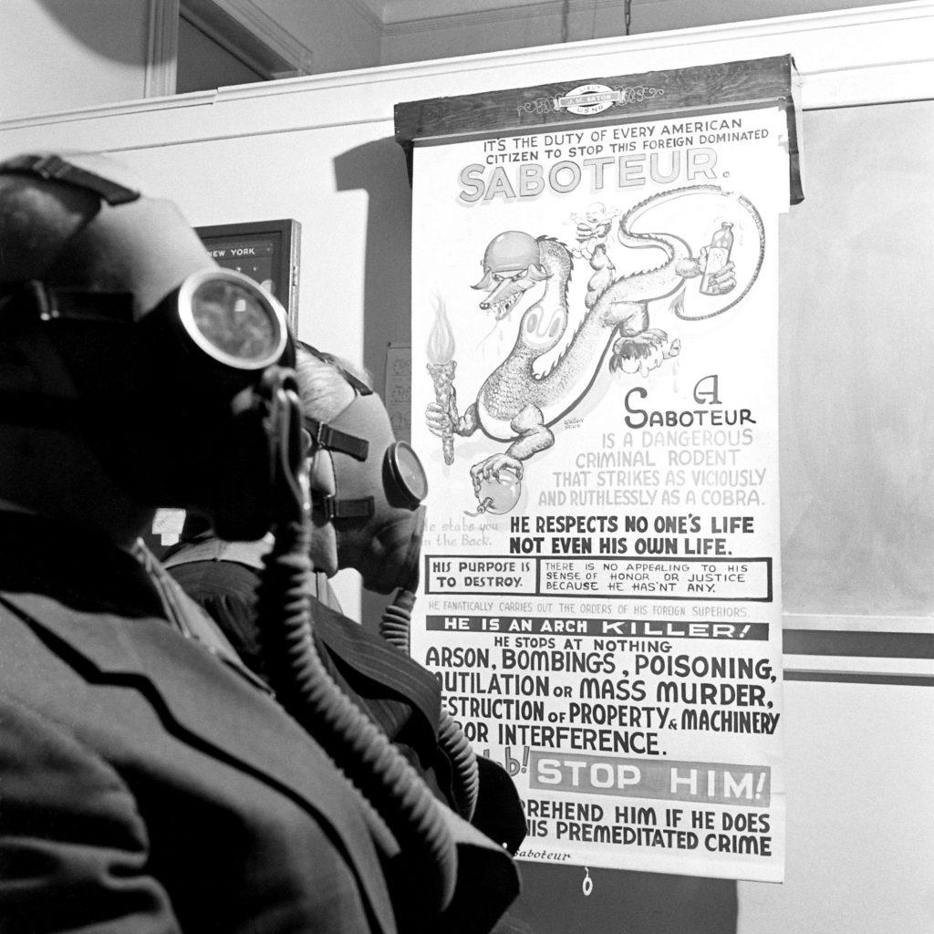 A poster at the Brooklyn Navy Yard calls for vigilance, December 1941.