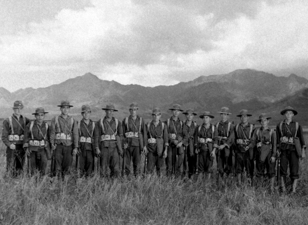 U.S. troops pose in Hawaii in the days after the attack on Pearl Harbor.