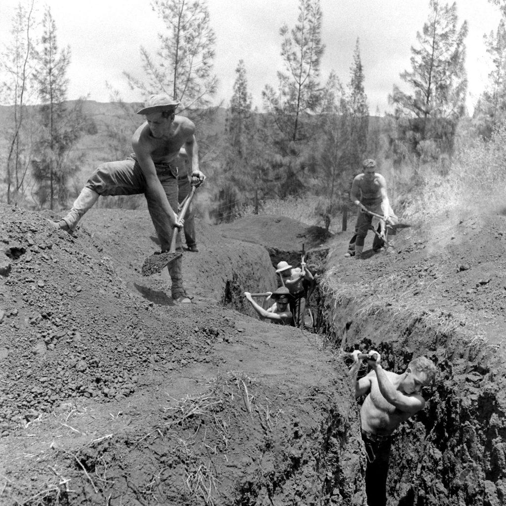 Men dig a post-Pearl Harbor defensive trench in Hawaii, December 1941.
