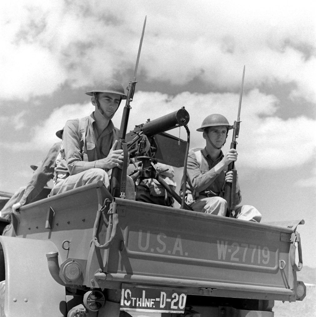 Young defenders beside a mounted machine gun, Hawaii, December 1941.