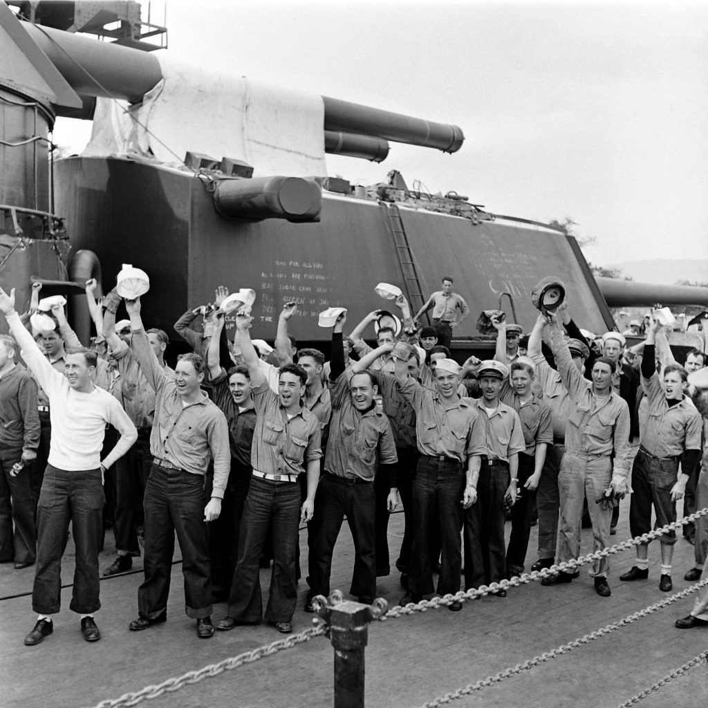An American warship's crew shows its spirit, Pearl Harbor, early 1942.