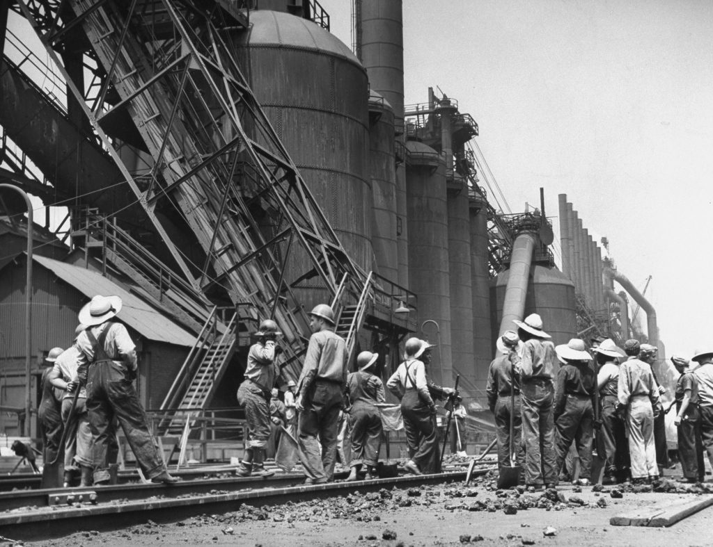 Women laborers clear tracks of spilled materials, Gary, Ind. 1943.