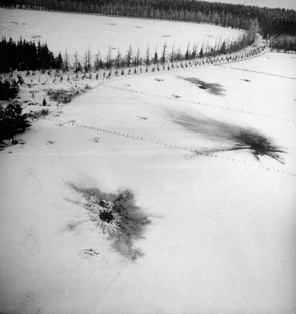 Shell craters left by an Allied barrage laid down to clean German infantry out of the woods and fields during the Battle of the Bulge, Belgium, 1944.