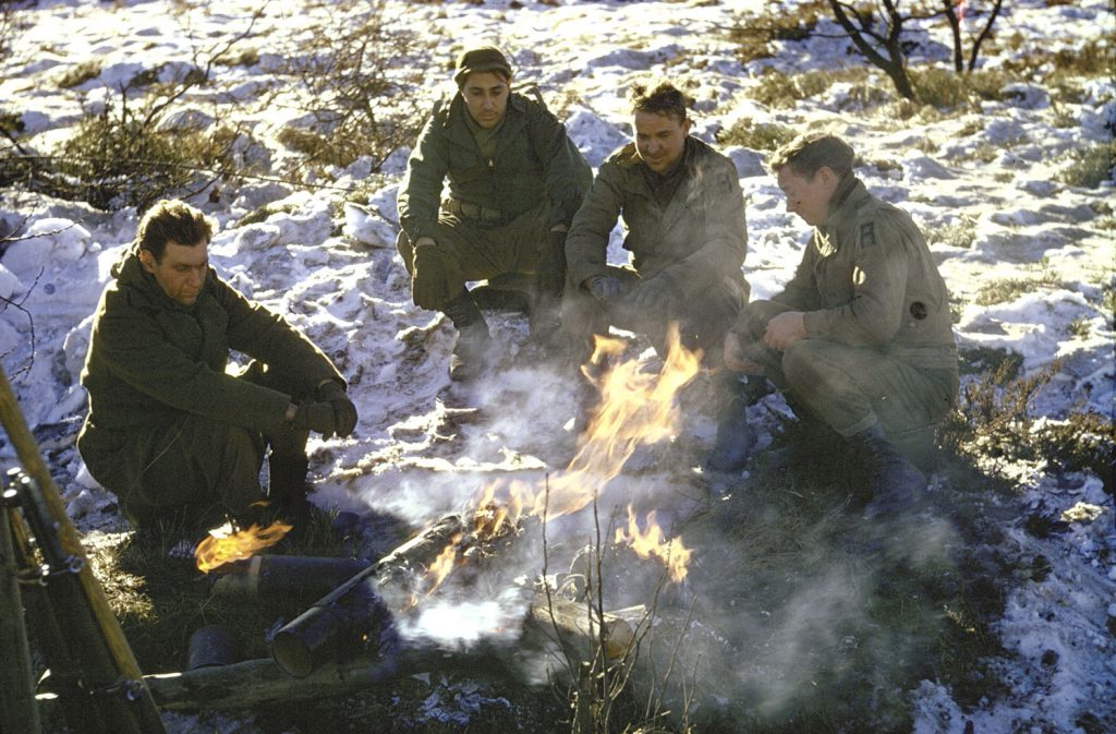 Allied troops around a fire in the Ardennes Forest during the Battle of the Bulge.