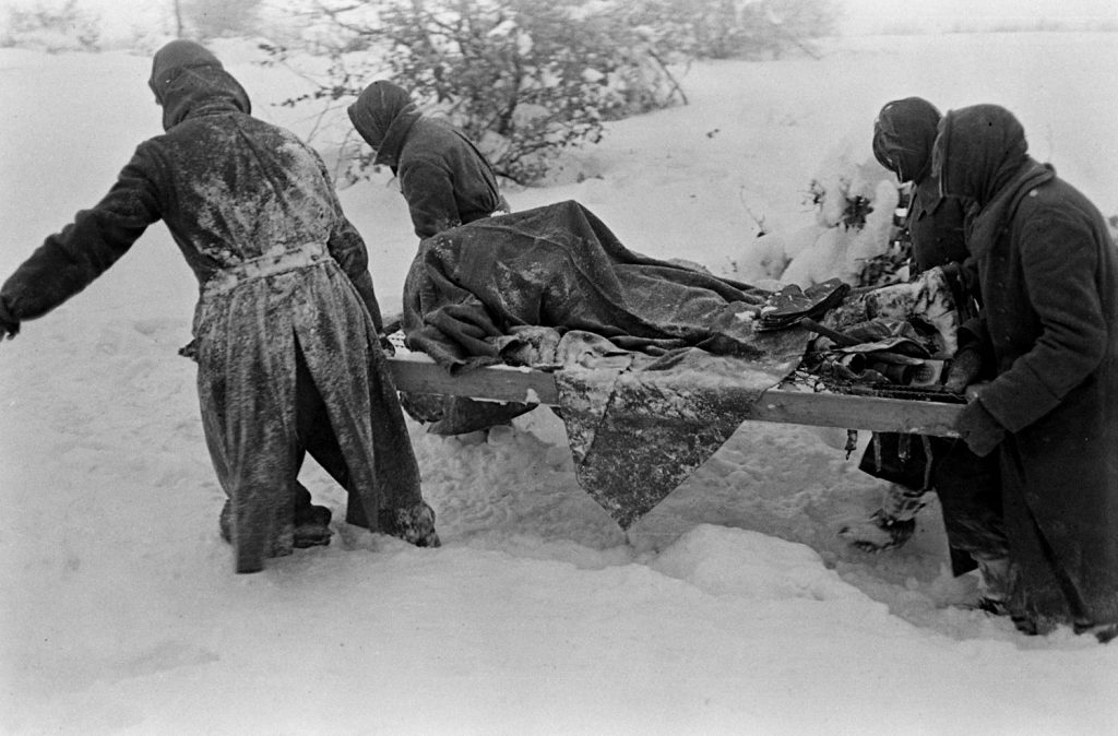 German POWs on grave-digging duty during the Battle of the Bulge.