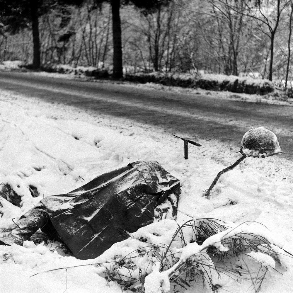 Corpse beside a road during the Battle of the Bulge.