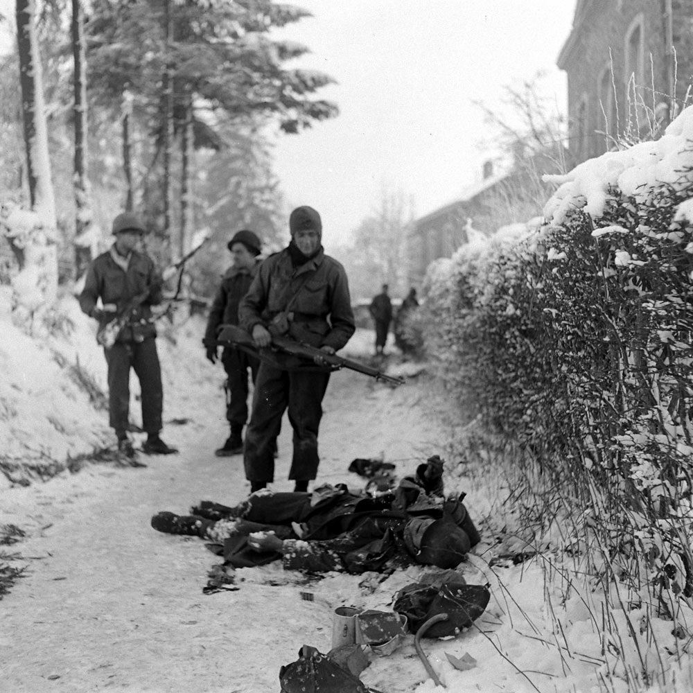 Allied troops and the German dead, Battle of the Bulge.