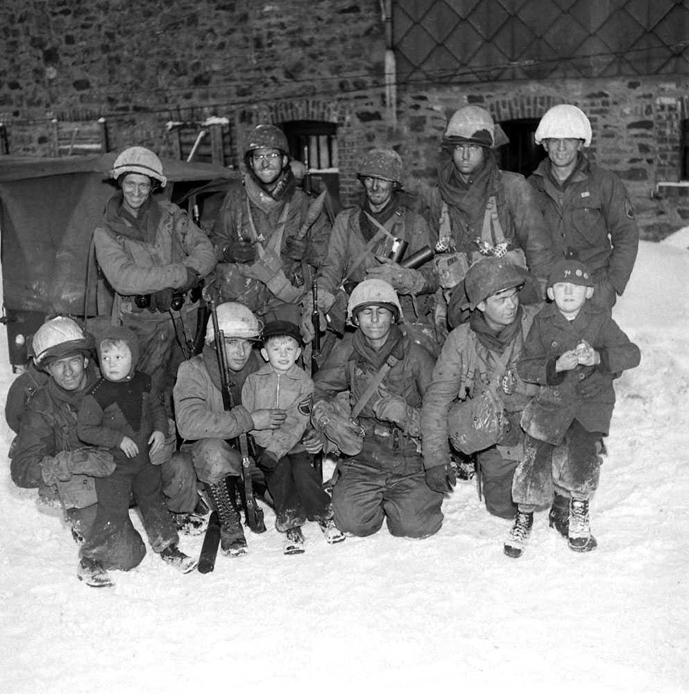 American troops with Belgian children, Battle of the Bulge.