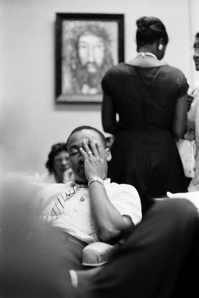 A weary Martin Luther King Jr. sits at the Rev. Ralph Abernathy's First Baptist Church in Montgomery, Ala., as a white mob surrounds the building.
