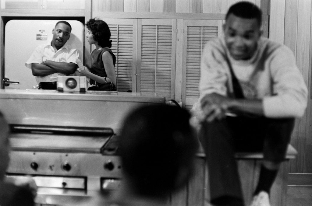 Freedom riders, along with Martin Luther King Jr., relax at a safe house in Montgomery, Ala.