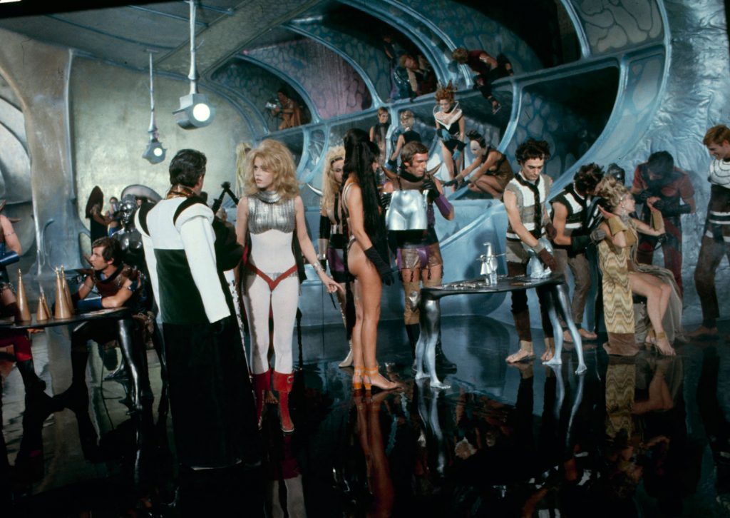 Jane Fonda (in white) and other cast members on the set of Barbarella, 1968.