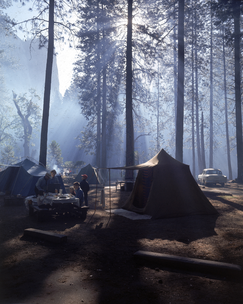 Campers make an early morning breakfast at their site in Yosemite National Park, 1962.