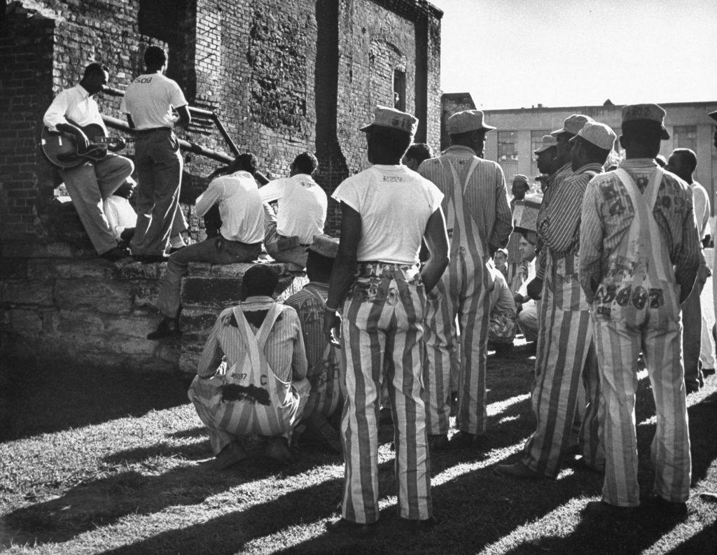 The incarcerated musical group the Prisonaires performs for other inmates, Tennessee State Penitentiary, 1953.