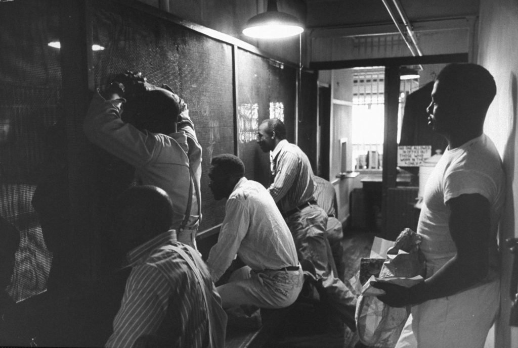 Prisoners talk through heavy screens to friends and relatives, Tennessee State Penitentiary, 1953.
