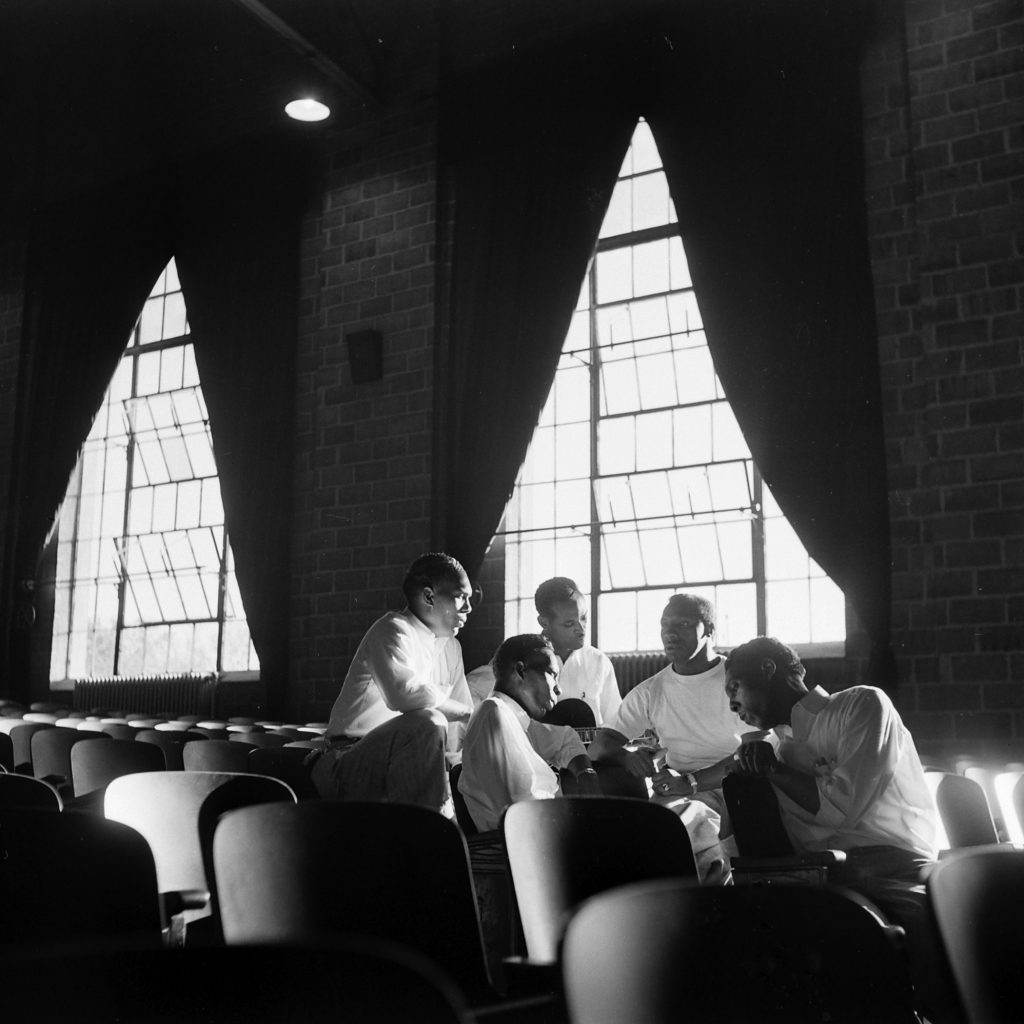 Members of the incarcerated musical group the Prisonaires rehearse in the prison auditorium, Tennessee, 1953.