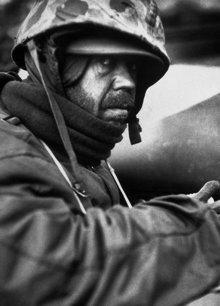 A weary American Marine hooded against the cold during the grim retreat from Chosin Reservoir, Korea, winter 1950.