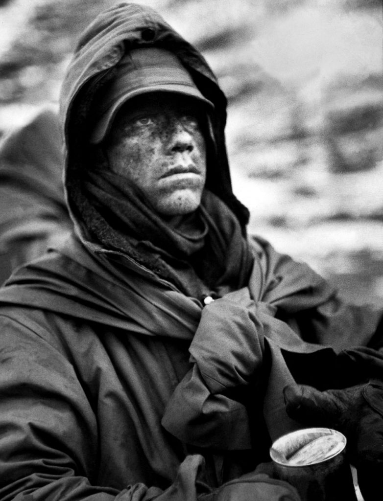 A dazed, hooded Marine clutches a can of food during his outfit's retreat from the Chosin Reservoir during the Korea War, December 1950.