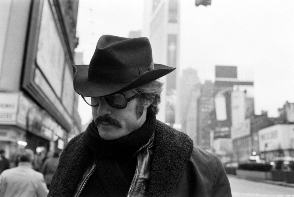 Robert Redford in Times Square, between meetings, 1969.