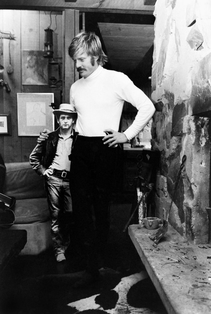 """Robert Redford (""""the Sundance Kid"""") with a cardboard cut-out of Paul Newman (""""Butch Cassidy""""), Utah, 1969."""