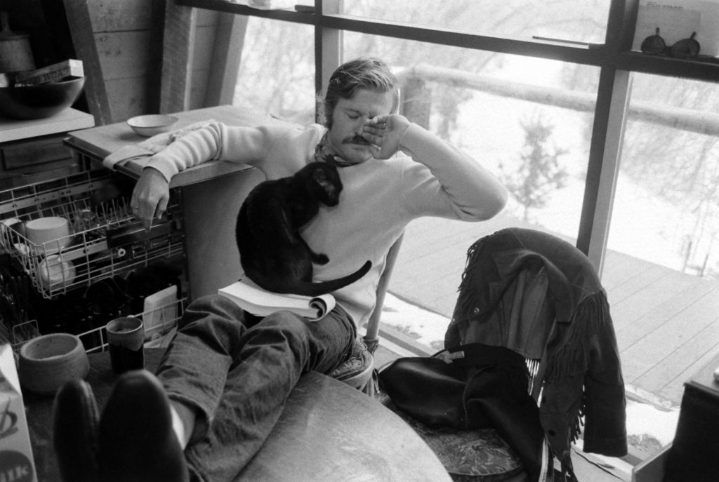Robert Redford takes a break from reading a script