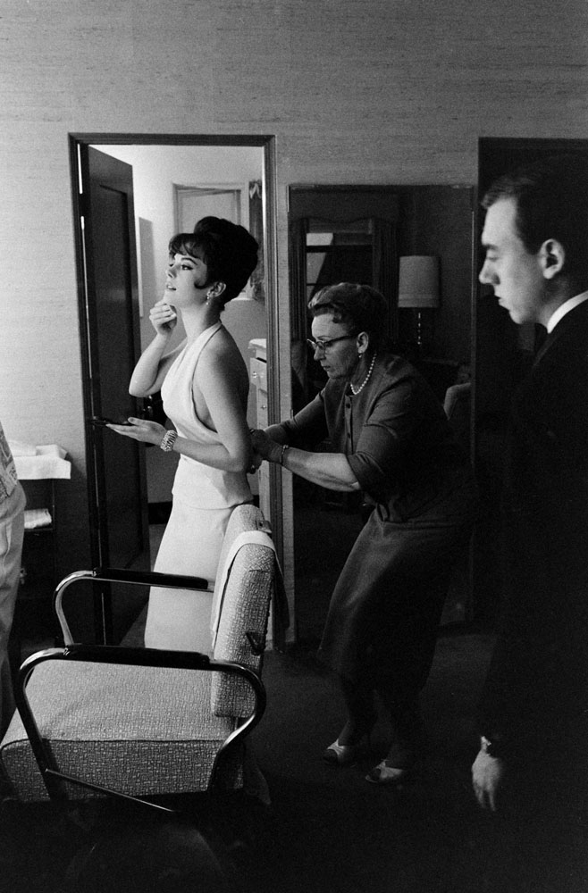 An assistant helps Natalie Wood into a showstopping, skin-baring number in April 1962.
