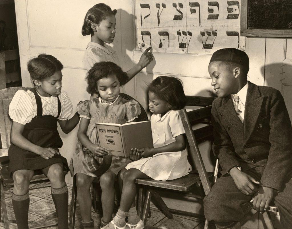 African American Jewish Congregation in Harlem, children studying, 1940.