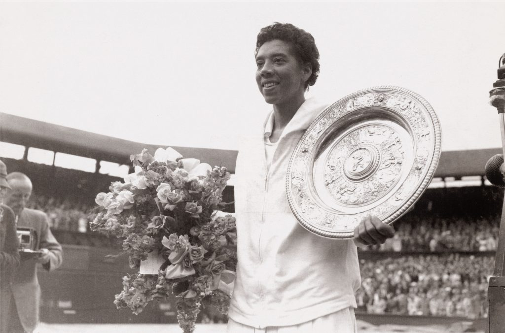 Althea Gibson holding a Wimbledon trophy plate, July 1957.