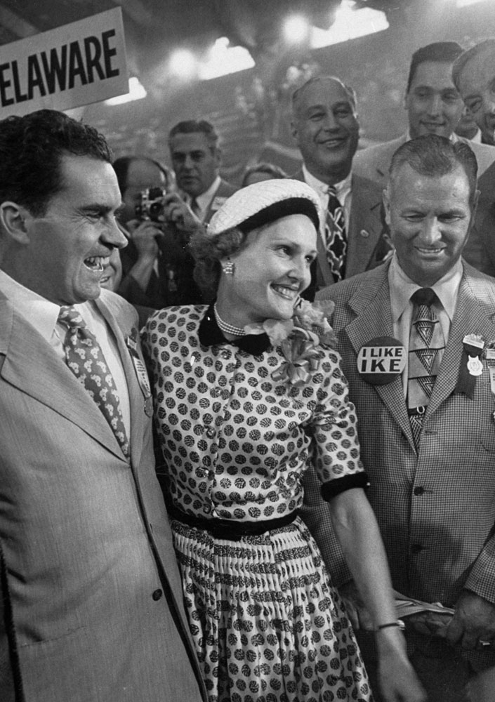 Vice-presidential nominee Richard Nixon and his wife Pat talk with photographers during the 1952 GOP National Convention in Chicago.