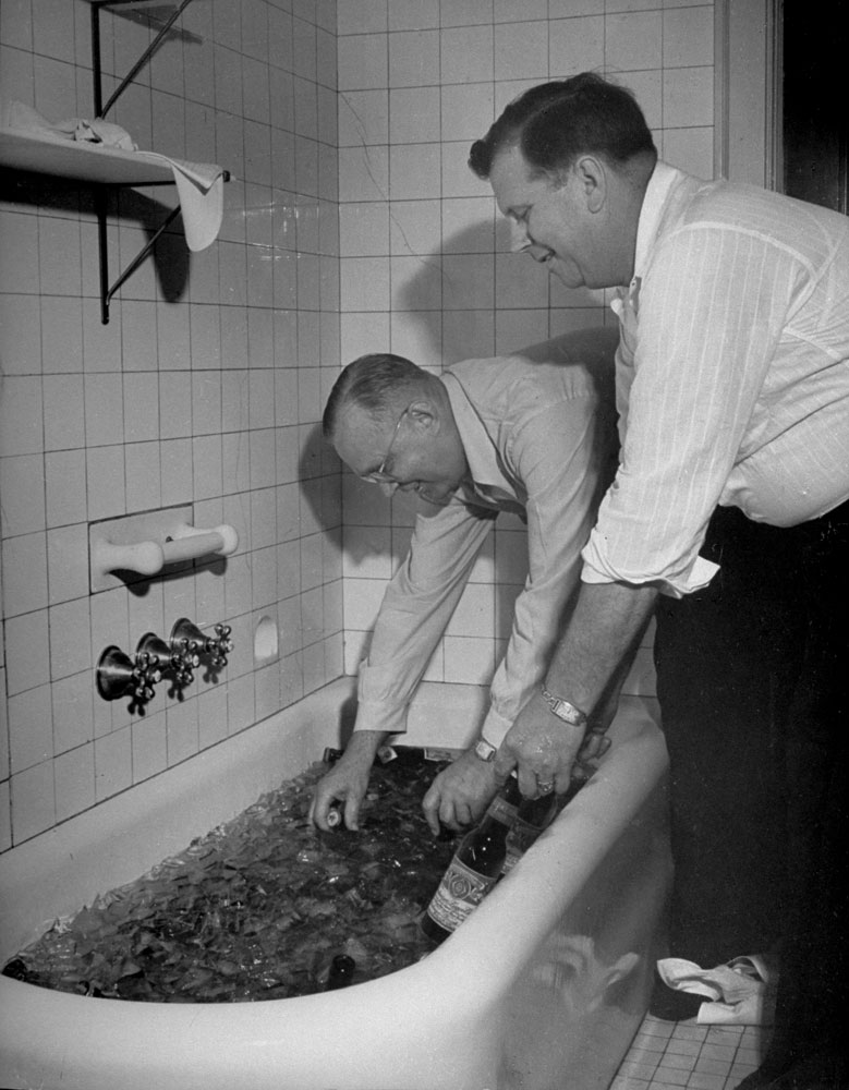 Pennsylvania delegates to the 1944 Republican National Convention in Chicago pull cold beers from a tub of ice after a caucus meeting.