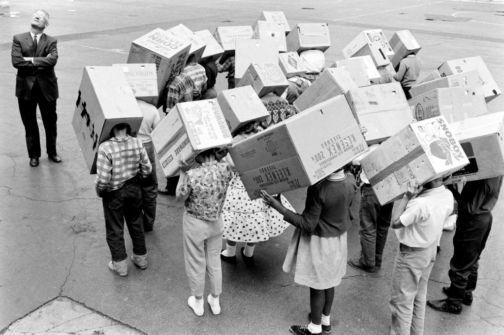 Children demonstrate how to watch a solar eclipse in 1963