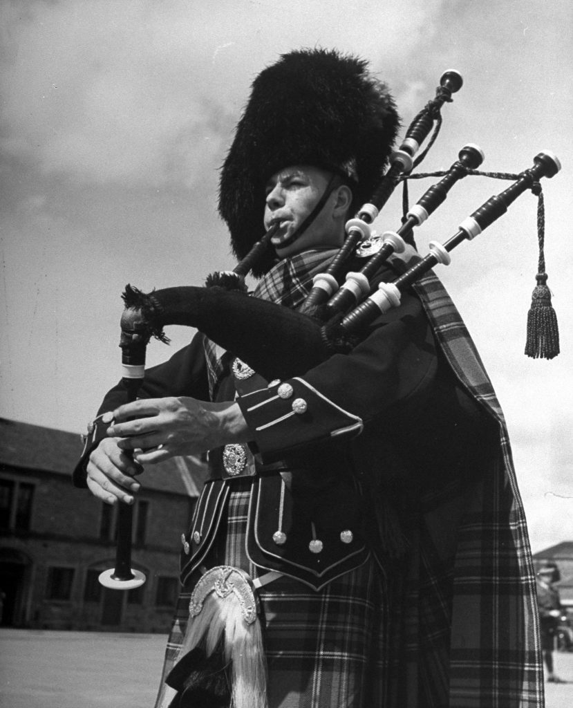 In full dress a piper of the famed Black Watch regiment pipes a pibroch at Perth Barracks.