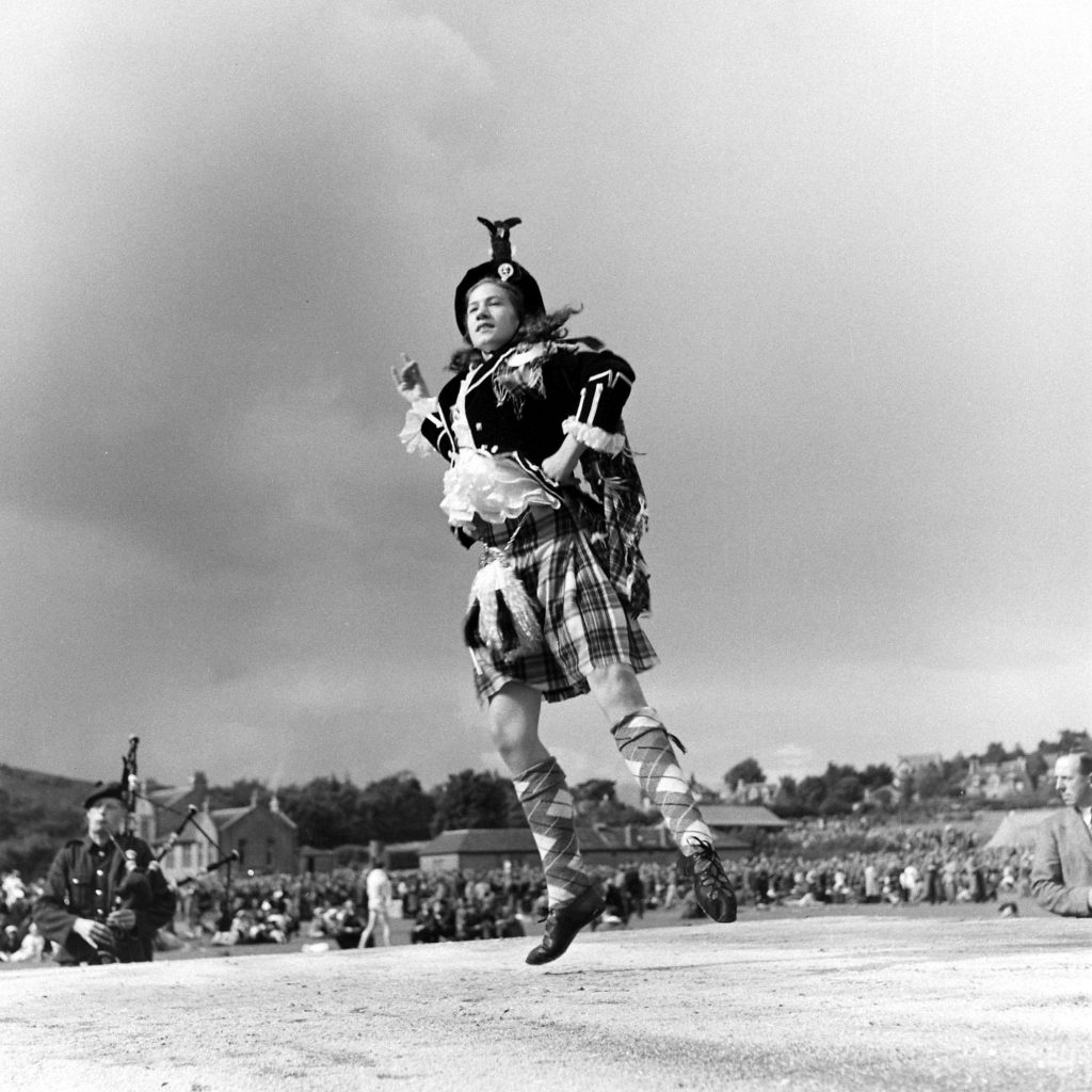 In Stewart Tartan an Aberdeen lass competes in a championship Highland dancing contest held each year at the Cowal gathering at Dunoon. Other events: piping, the fling.