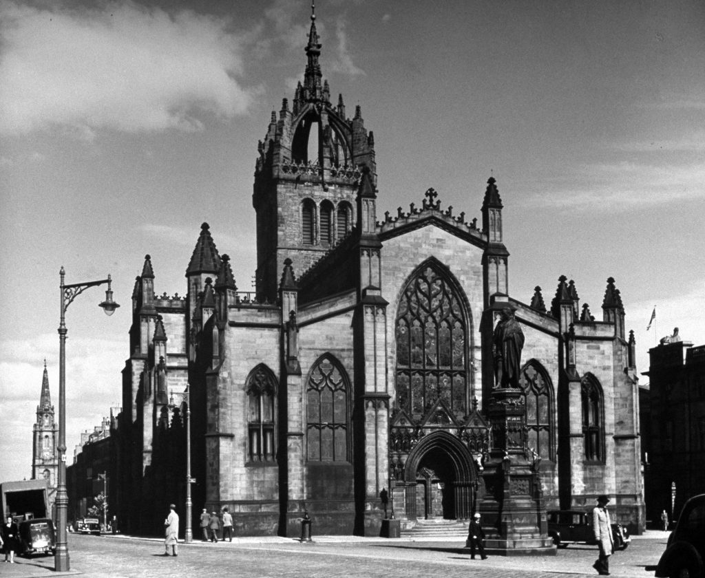 St. Giles Church is where Knox preached. Near it, in now-vanished yard, he may be buried. Nearby also stood Tollbooth Prison (Scott's Heart of Midlothian).