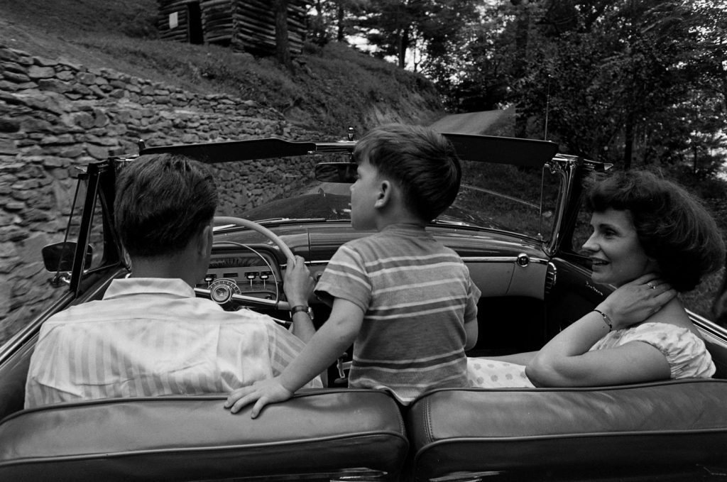 Billy Graham, his son, Franklin, and his wife, Ruth, in a car, 1955.