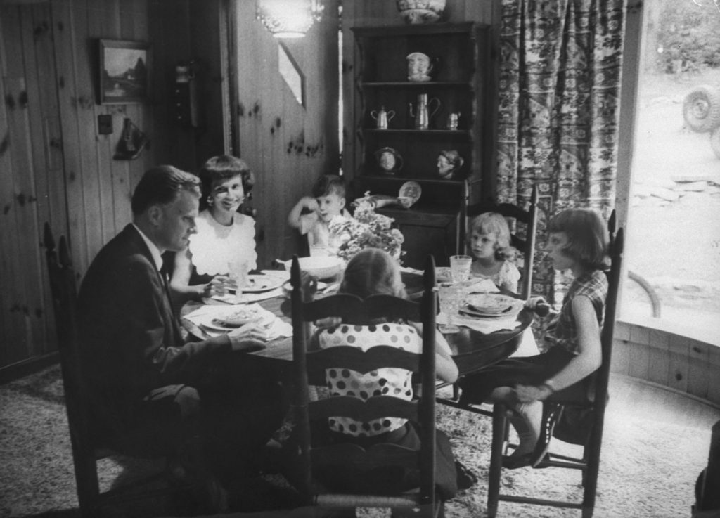 Billy Graham and family at a meal, 1955.