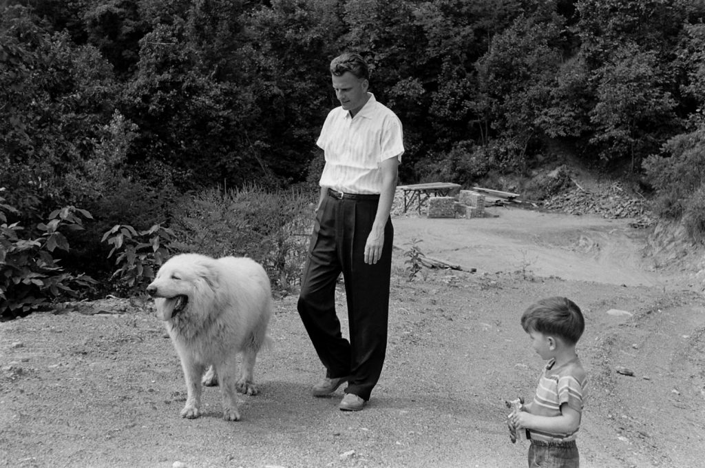 The Rev. Billy Graham with his son, Franklin, and the family dog in 1955.