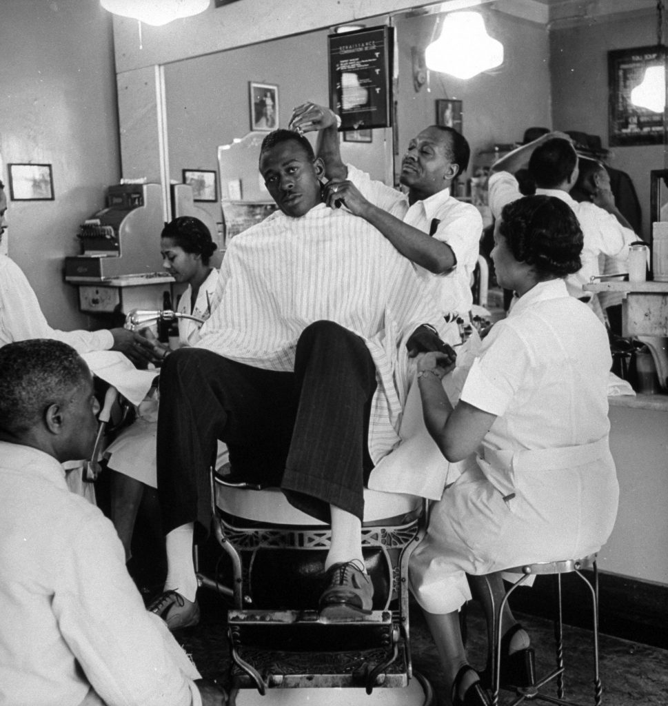 Satchel gets shined, clipped and manicured on three sides at once.