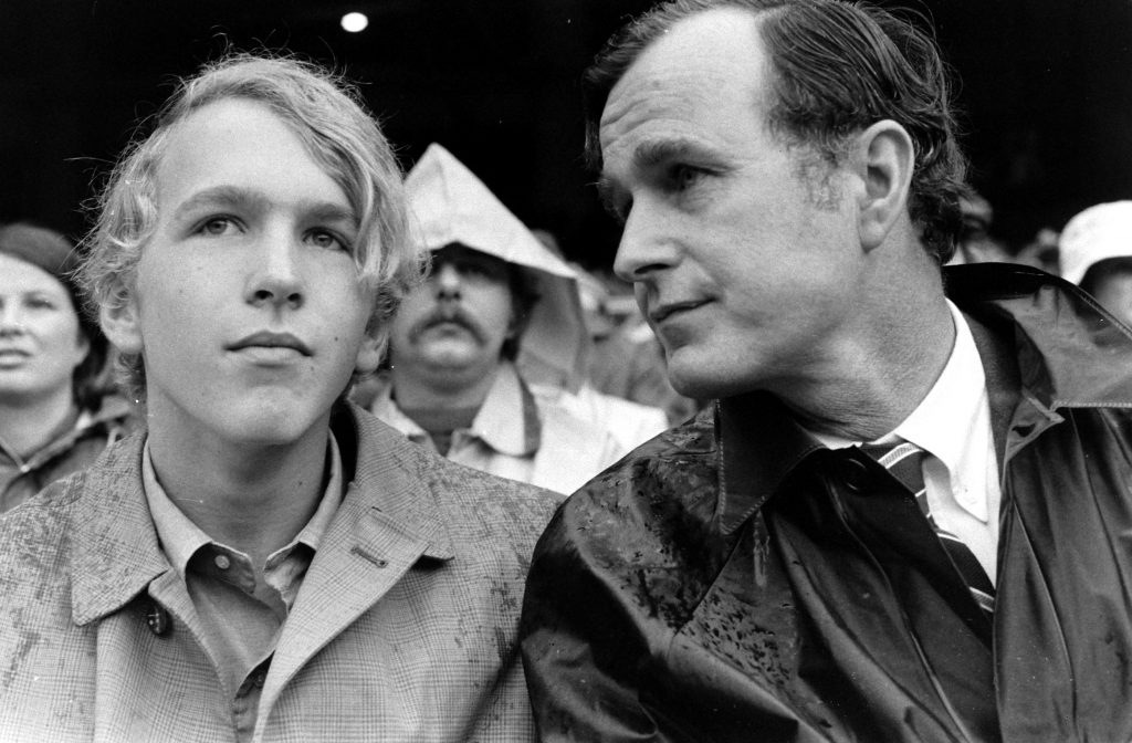 George H.W. Bush at a baseball game with son Marvin in 1971.